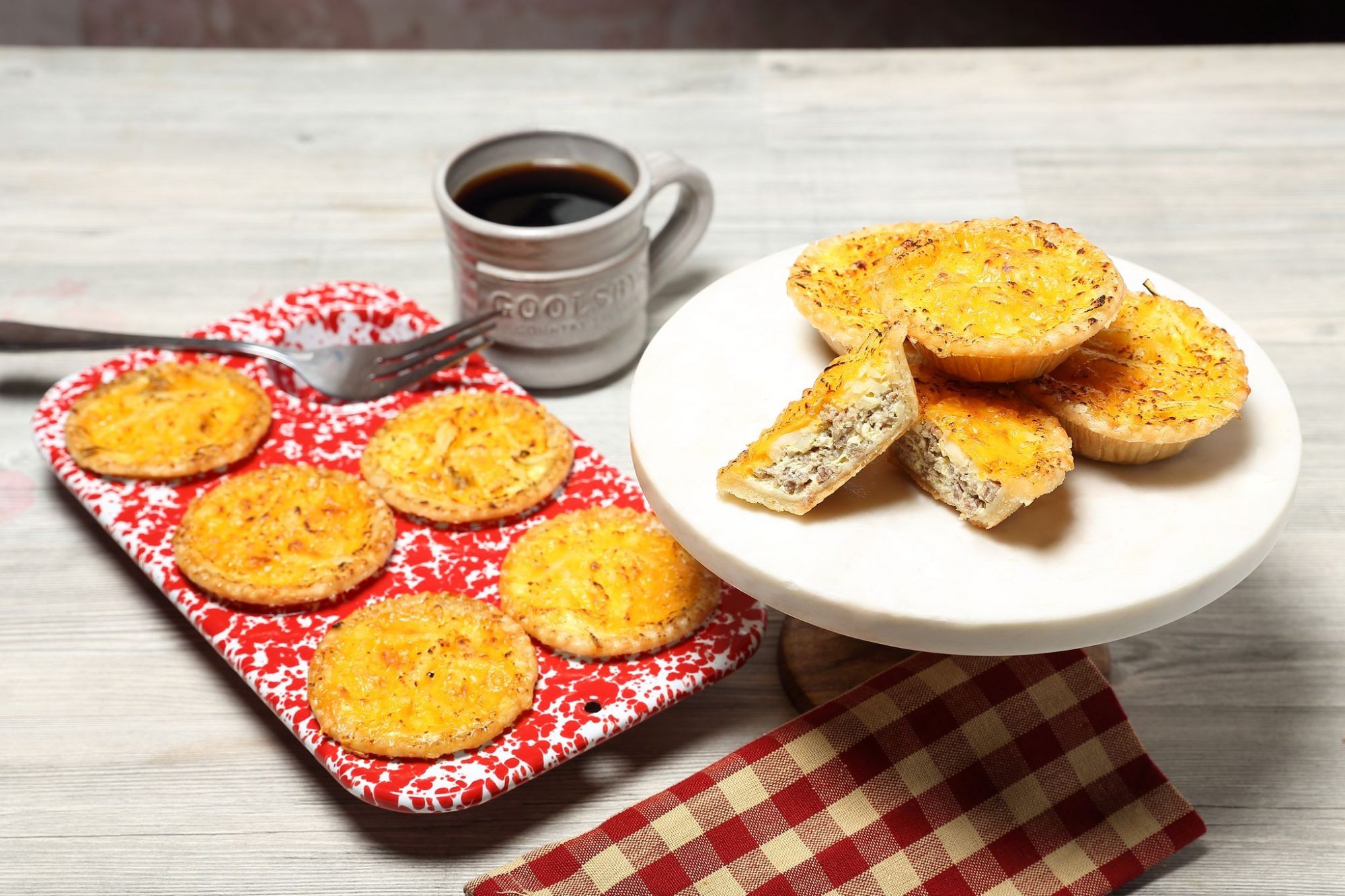 Sausage, cheese and hashbrown breakfast tarts with a cup of coffee